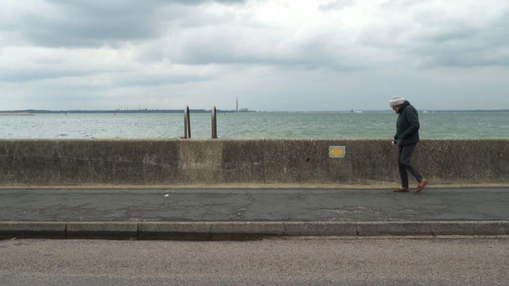 Woman walking on East Cowes esplanade